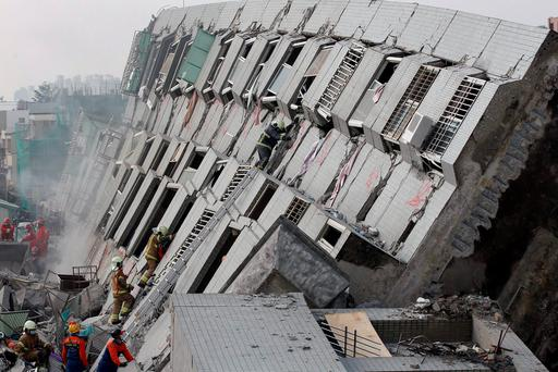 Rescue personnel work at the site where a 17-storey apartment building collapsed during the earthquake in Tainan. Photo: Reuters