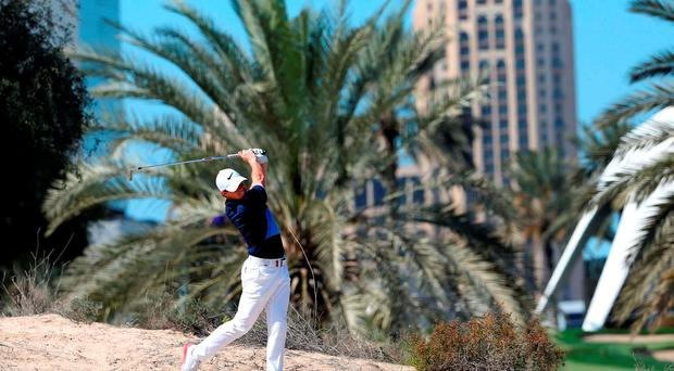 Rory McIlroy of Ireland plays a shot during the final round of the 2016 Dubai Desert Classic