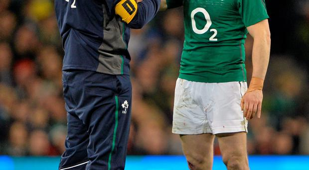 Brian O'Driscoll is attended to by team doctor