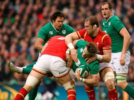 Ireland's Jamie Heaslip is tackled by Wales' Alun Wyn Jones and Luke Charteris