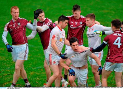 Tyrone players, from left, Ronan O'Neill, Sean Cavanagh, Mark Bradley and Lee Brennan, tussel with Galway players, from left, Declan Kyne, Daithi O Gaoithin, Johnny Kerin, Thomas Dolan and Eoghan Kerin