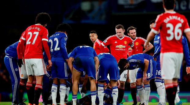 Chelsea's French defender Kurt Zouma (C) lies injured during the English Premier League football match between Chelsea and Manchester United