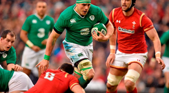 CJ Stander, Ireland, is tackled by Sam Warburton, Wales.