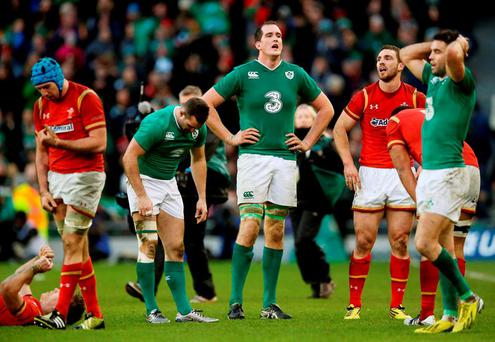 Ireland and Wales players react after playing out a draw in the 2016 RBS Six Nations match at the Aviva Stadium