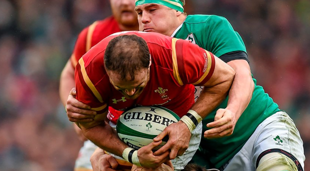 Welsh centre Jamie Roberts is tackled by Ireland flanker CJ Stander. Picture credit: Ramsey Cardy / SPORTSFILE