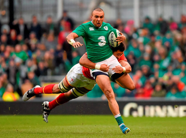 Ireland's Simon Zebo is tackled by Taulupe Faletau during their draw. Picture credit: Stephen McCarthy / Sportsfile