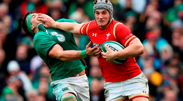 Jonathan Davies hands off CJ Stander. Photo: Getty