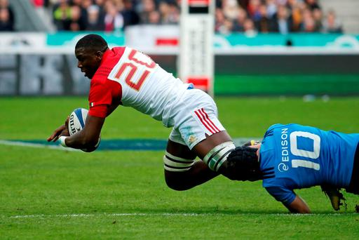 France's Yacouba Camara (L) is tackled by Italy's Carlo Canna. Photo: Reuters