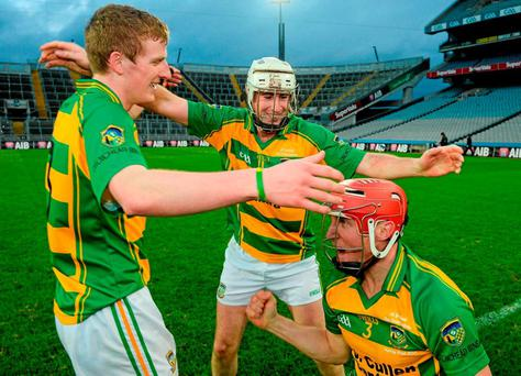 Bennettsbridge team-mates Seán Morrissey, Nickey Cleere, and Robert Lennon celebrate after the game. Photo: Cody Glenn / Sportsfile