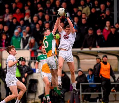 Kildare's Cathal McNally in action against Conor McNamee of Offaly during their Allianz NFL Division 3 clash. Photo: Paul Mohan / Sportsfile