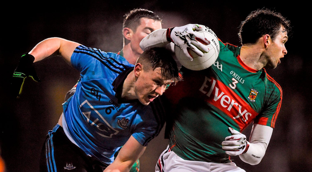 Mayo full-back Ger Cafferkey manages to take the ball away from Dublin's John Small during Saturday's encounter in MacHale Park. Photo: Sportsfile