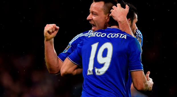John Terry celebrates with Diego Costa after the striker's last minute equaliser against Manchester United. Photo: Getty