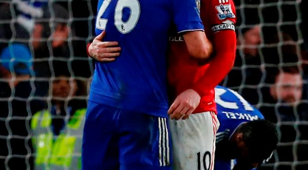 Chelsea's John Terry embraces Manchester United's Wayne Rooney following the game. Photo: Getty