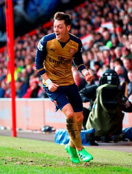 Mesut Oezil of Arsenal celebrates as he scores their first goal. Photo: Getty