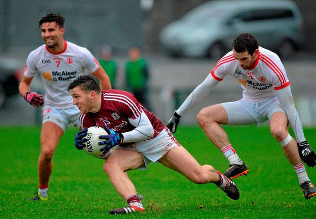 Galway corner-forward Damien Comer is closed down by Tyrone pair Ronan McNamee, right, and Tiernan McCann during yesterday's Allianz NFL Division Two clash at Pearse Stadium. Photo: Matt Browne / Sportsfile
