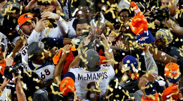 Denver Broncos' Brandon McManus (8) holds the Vince Lombardi Trophy after the Broncos defeated the Carolina Pathers in the NFL's Super Bowl 50 football game in Santa Clara, California February 7, 2016. REUTERS/Michael Fiala
