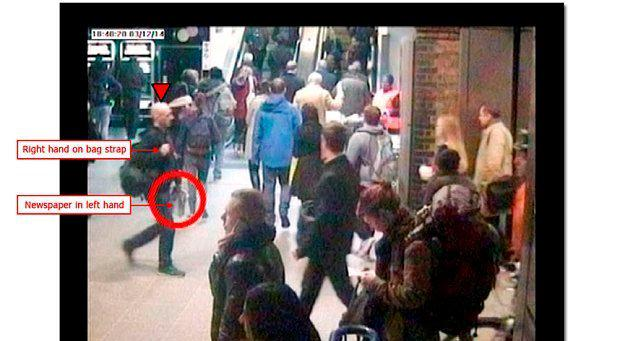 Mr Pearson seen carrying a bag and a newspaper on CCTV footage recorded at Waterloo Underground Station at 18:40:20