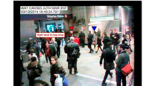 Mr Pearson seen with his right hand on his bag strap on CCTV footage recorded at Waterloo Underground Station at 18:40:24
