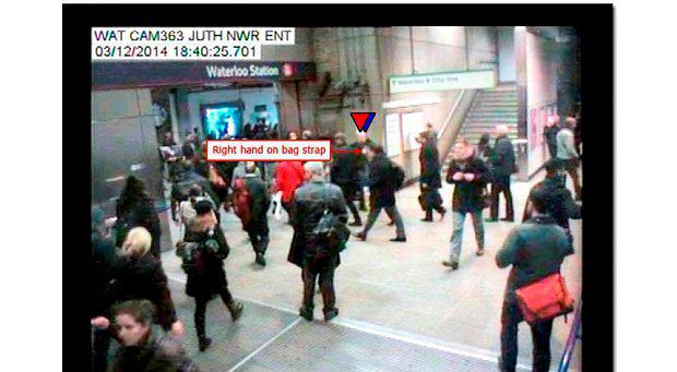 Mr Pearson seen passing the woman on CCTV footage recorded at Waterloo Underground Station at 18:40:25