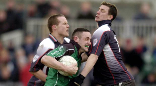 The late Peter Turley, centre, in action during the Sigerson Cup final in 2005