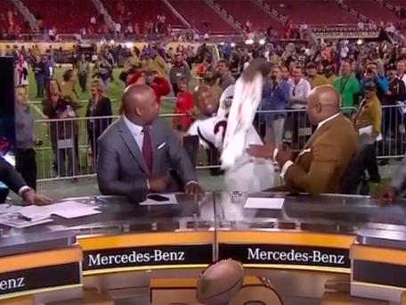 Aqib Talib slips head over heels during interview after Denver Broncos win