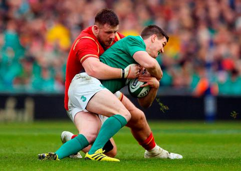 Ireland's Johnny Sexton and Wales' Rob Evans during the 2016 RBS Six Nations match at the Aviva Stadium