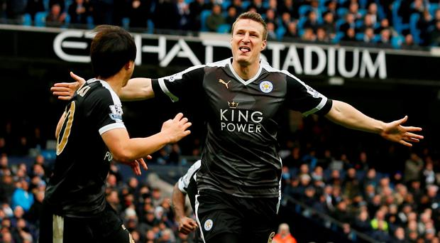 Leicester City's Robert Huth celebrates scoring their third goal in the win over Manchester City Action Images via Reuters / Jason Cairnduff