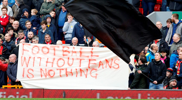 Supporters at Anfield unfurl a banner during Saturday's game against Sunderland. Photo: Reuters / Carl Recine