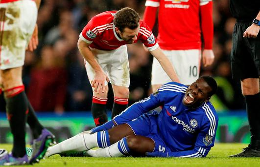 Chelsea's Kurt Zouma lies on the pitch after sustaining an injury during Sunday's match against Manchester United. Photo: John Sibley/ Reuters