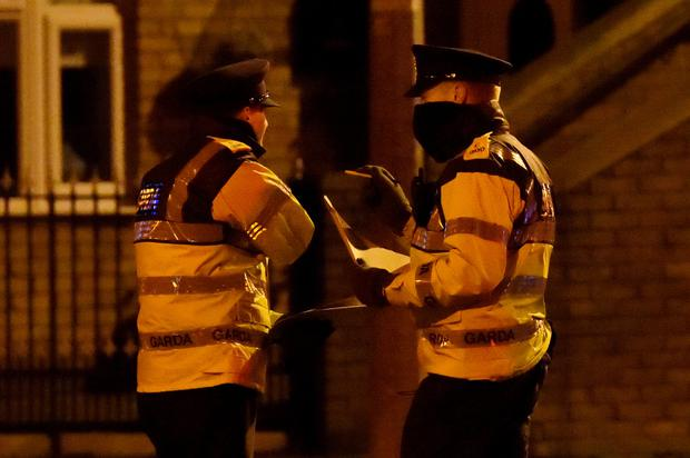 Police officers attend to the scene of a shooting at Poplar Row in Dublin, Ireland February 8, 2016. Reuters/Clodagh Kilcoyne