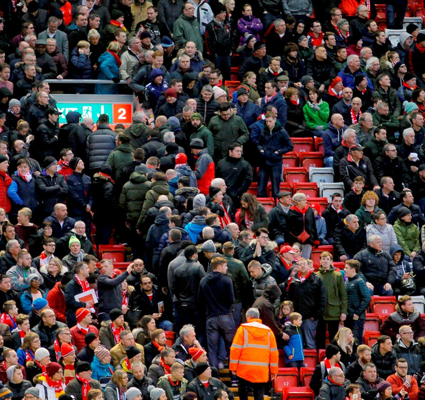 Liverpool fans walk out after 77 minutes during Saturday's Premier League match at Anfield. Photo: Richard Sellers/PA