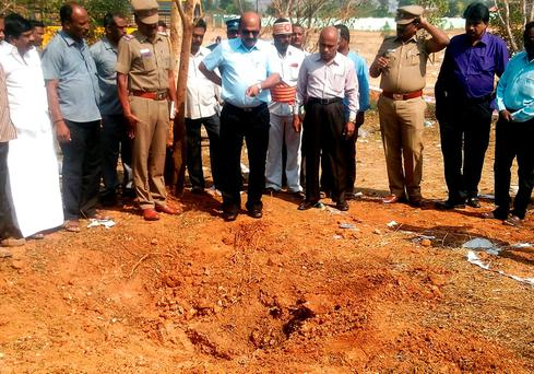 Indian authorities inspect the site of a suspected meteorite landing in Vellore district in southern Tamil Nadu state in an impact that killed a bus driver and injured three others on February 6. Photo:AFP/Getty Images