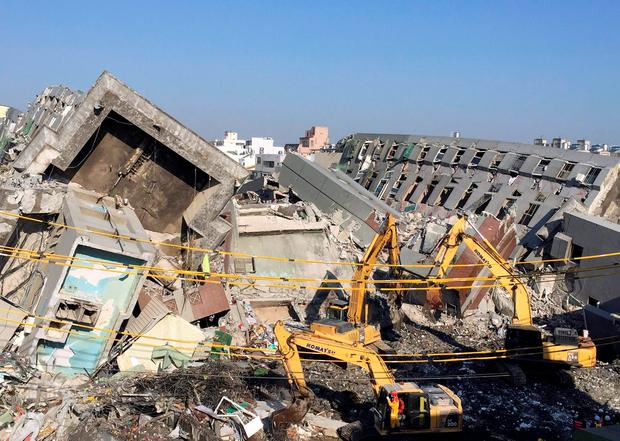 Rescue workers using excavators continue to search the rubble of a collapsed building complex in Tainan, Taiwan, Tuesday, Feb. 9, 2016.
