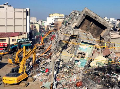Rescue workers using excavators continue to search the rubble of a collapsed building complex in Tainan, Taiwan, Tuesday, Feb. 9, 2016