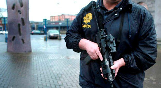 A member of the Garda ERU holds an MP7 File Picture