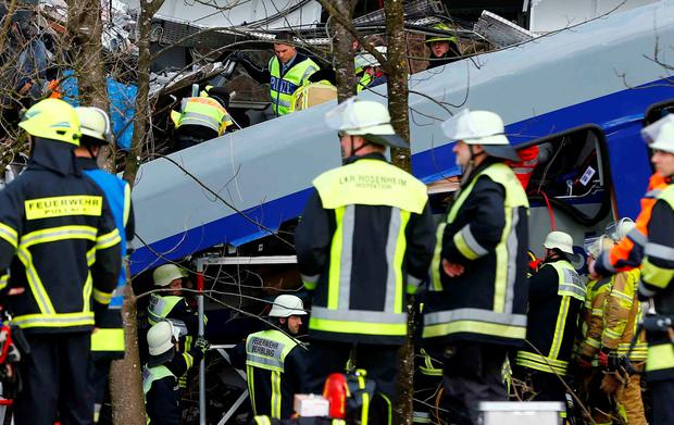 Rescue personnel work at the wreckages of two trains that collided head-on near Bad Aibling, southern Germany, Tuesday, Feb. 9, 2016.
