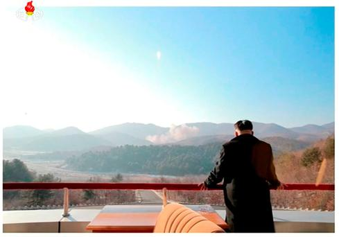 North Korean leader Kim Jong Un watches a long range rocket launched into the air in this still image taken from KRT file footage and released by Yonhap on February 7, 2016. Reuters/Yonhap/Files
