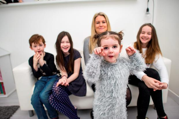 Hip mom: Julie Farrell at home in Dundrum with her children Dylan (7), Sarah (9), Birdie (3) and Rebecca (13). Photo: Doug O'Connor.