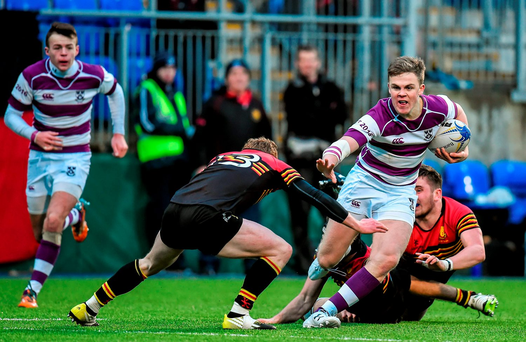 Clongowes Wood's Michael Silvester tries to break through the Monkstown defence: Brendan Moran / SPORTSFILE