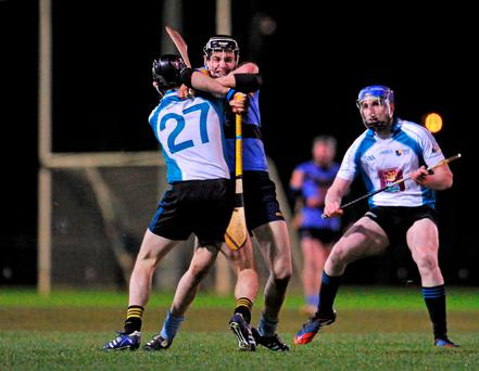 UCD's Jack O'Connor takes on David Hennessy of Maynooth in last night's encounter: Sam Barnes / SPORTSFILE