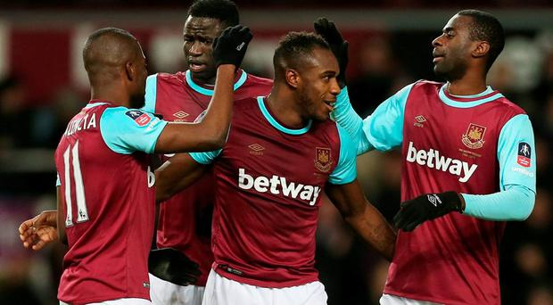 Michail Antonio celebrates with team mates after scoring the first goal for West Ham