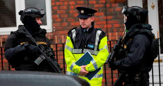 Armed gardai from the force's Emergency Response Unit on patrol in the north inner city. Photo: PA