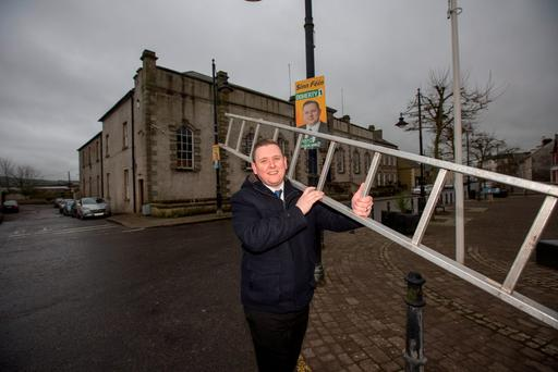 Councillor Gary Doherty putting up posters in Lifford, Co Donegal. Photo: Mark Condren