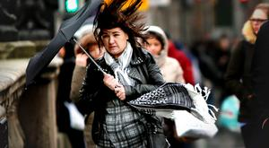 A pedestrian struggles with an umbrella in Dublin city centre. Photo: Gerry Mooney
