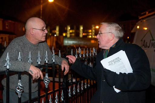 Christy Burke speaks to local man Barney Bolger while canvassing in the Sheriff Street area of Dublin. Photo Arthur Carron