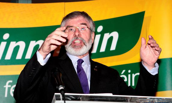 Sinn Féin leader Gerry Adams speaking at the launch of the party's election manifesto at the Royal Irish Academy on Dawson Street in Dublin yesterday. Photo: Tom Burke