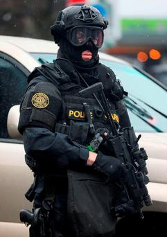 A member of the Garda Emergency Response Unit on patrol in Dublin . Photo: PA