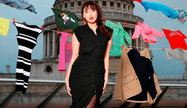Daisy Lowe hangs up donated clothes to launch the TK Maxx Give up Clothes for Good campaign in support of Enable Ireland. Picture: Matt Alexander/PA Wire