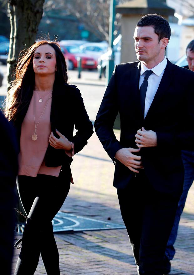 England footballer Adam Johnson, 28, and partner Stacey Flounders arrive at Bradford Crown Court, Bradford