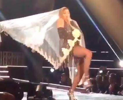 Madonna battles her veil on stage in Bangkok